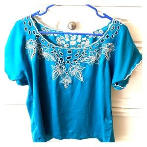 Blue flow-y blouse with a white flower embroidery